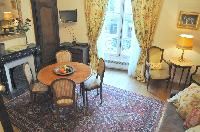 distinctively warm, authentic, and gorgeous 1-bedroom Paris luxury apartment with exposed beams and