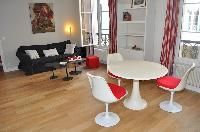 bright and modern open plan living and dining room in Paris luxury apartment