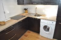well-equipped kitchen with washer in Paris luxury apartment