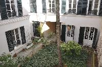 overlooking the quiet courtyard from the windows of Paris luxury apartment