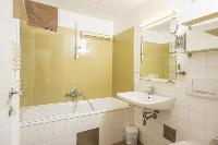spic-and-span bathroom with tub in Vienna - Apartment 2 with Private Terrace luxury holiday home and