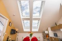 amazing slanted windows of Vienna - Apartment 3 Attic luxury holiday home and vacation rental