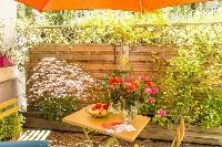 neat garden terrace of Vienna - Apartment 5 Cozy Studio luxury holiday home and vacation rental