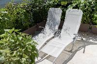 cool sun loungers at Vienna - Golf Apartment luxury vacation rental and holiday home