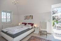 crisp and clean bedroom linens in Vienna - Golf Apartment luxury vacation rental and holiday home