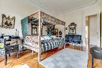 third bedroom with a queen-sized bed in a 4-bedroom Paris luxury apartment