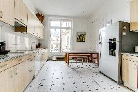 well-equipped kitchen in a 4-bedroom Paris luxury apartment