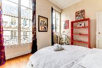 fourth bedroom with a unique round King-sized bed in a 4-bedroom Paris luxury apartment