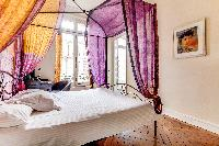 luxurious master suite features a 4-poster bed especially imported from Bali, and with plenty of sto