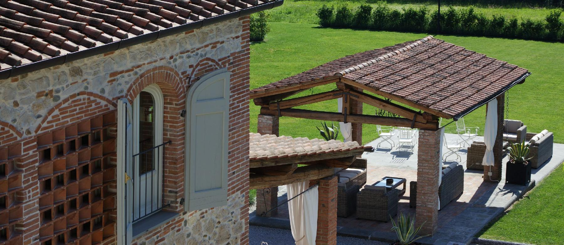 well-manicured lawn of Tuscany - The Tuscan Mansion luxury apartment