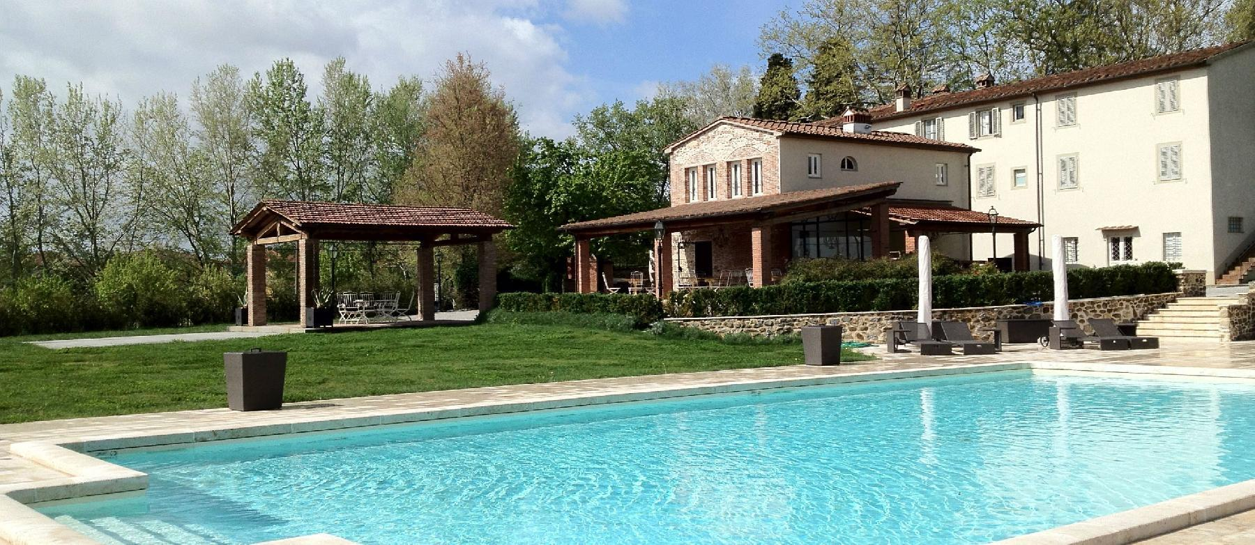 amazing swimming pool of Tuscany - The Tuscan Mansion luxury apartment