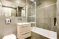 fresh and clean bathroom with tub in République - Voltaire luxury apartment
