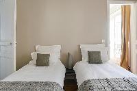 pristine bed sheets and pillows in République - Voltaire luxury apartment