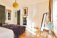 cheerful bedroom in République - Voltaire luxury apartment