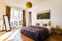 lovely bedroom with balcony at République - Voltaire luxury apartment