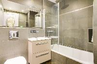 clean and fresh bathroom with tub in République - Voltaire luxury apartment