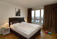 pristine bedroom linens in Vienna - Studio with Balcony luxury apartment