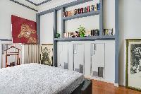 master bedroom with a queen size bed in a 2-bedroom Paris luxury apartment