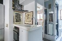 well-kept and modern bathroom and kitchen sink in a 2-bedroom Paris luxury apartment