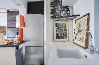 well-equipped kitchen in a 2-bedroom Paris luxury apartment