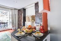 well-ventilated dining area in a 2-bedroom Paris luxury apartment