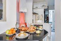 well-ventilated dining area and well-equipped kitchen in a 2-bedroom Paris luxury apartment