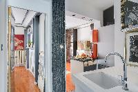 well-equipped kitchen and hallway in a 2-bedroom Paris luxury apartment
