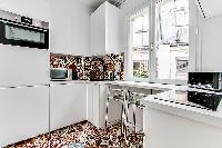 modern and fully functional kitchen in a 3-bedroom Paris luxury apartment
