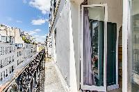 balcony with street view in a charming studio Paris apartment