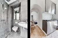 modern contemporary designed bathroom and kitchen in a charming studio Paris apartment