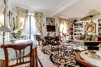 bright and spacious living area  in a 1-bedroom Paris luxury apartment