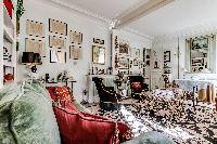 elegantly decorated living area with a handful of decors, elegant furniture, and numerous works of a