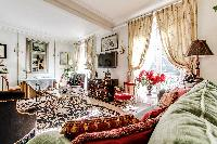 elegantly decorated living area with a handful of decors,elegant furniture, and numerous works of ar