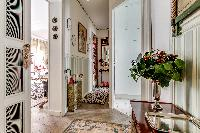 a hallway with parquet floors in a 1-bedroom Paris luxury apartment