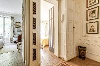 hallway with access to the bedroom and living room in 3-bedroom Paris luxury apartment