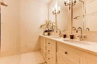 elegant bathroom finished with marbles and fancy tiles in 3-bedroom Paris luxury apartment