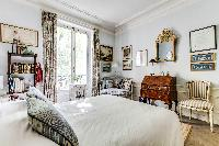 beautiful and well-appointed bedroom in 3-bedroom Paris luxury apartment