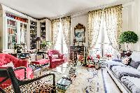 living room with detailed interior design with  huge glass windows that open to a terrace in 3-bedro