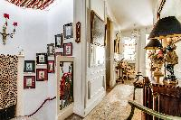 massively decorated hallway with access to the stairs and living room in 3-bedroom Paris luxury apar
