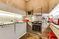 modern fully equipped kitchen in 3-bedroom Paris luxury apartment