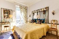 bedroom fitted with queen size bed and huge glass windows with access to the lovely terrace in 3-bed