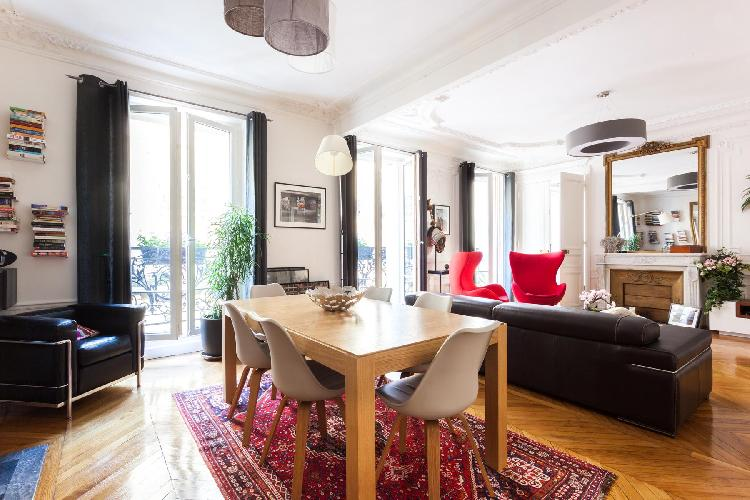 open plan living and dining area with quintessentially Parisian foundations – parquet flooring and F
