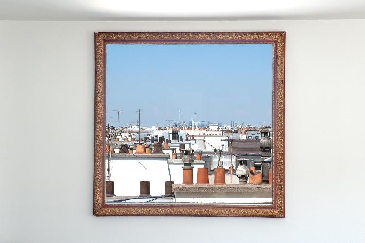 metal framed photograph on white wall in Paris luxury apartment