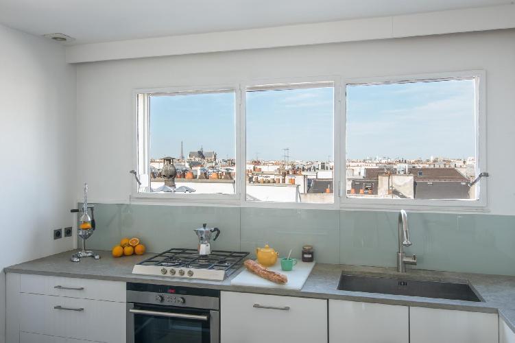 sleek white-and-grey kitchen in Paris luxury apartment