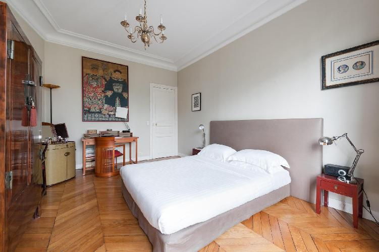 master bedroom's contrastingly refined and dreamy space in Paris luxury apartment