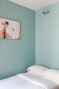 clean and fresh bedroom linens in Paris - Rue Turbigo luxury apartment