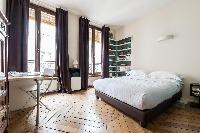 awesome master bedroom with balcony at Paris - Rue Turbigo luxury apartment
