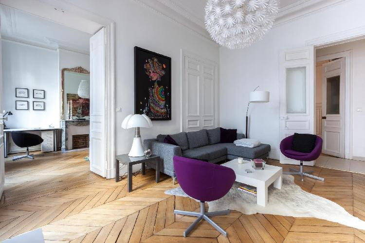 living area with collection of vivid artworks from graffiti-style portraits to colorful mosaics in P