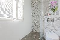 stylishly decorated bathand shower area in Paris luxury apartment