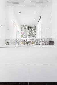 double sink and mirror in Paris luxury apartment